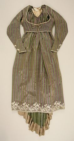 Round Gown ca. 1795; Met 1979.20a-g. Ensemble includes gown, separate stays, sleeveless spencer, and separate sleeves (probably left over from an earlier styling of the gown), all from the same striped silk satin fabric. This is a flat view of the dress with sleeveless spencer. It laces closed in the modern style (not spiral). Eyelets embroidered; original lace? Plain white/cream lining. Back neckline higher than gown. Sweat stains show it has been worn a great deal.