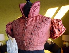 """Spencer in silk - c1810.  """"Beautiful stand-up collar, short sleeves. Passament embroidery / ornamental trimmings in front and back. 23 hand made decoration-buttons."""" (found via Kath)"""