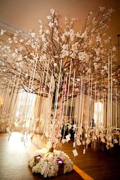 Incredible tree and ribbon escort card display - Photo by Brett Matthews Photography/Florals by: Tantawan Bloom