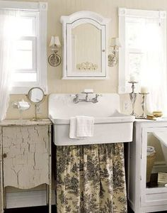 Cute toile skirt under the sink.