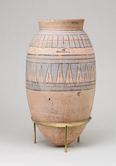 Blue-Painted Jar from Malqata  Period:      New Kingdom  Dynasty:      Dynasty 18  Reign:      reign of Amenhotep III  Date:      ca. 1390–1353 B.C. It's at the Metropolitan Museum of Art, also.
