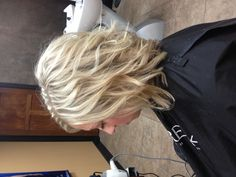 Slightly inverted bob, with long layers. Color: heavy full head weave of blonde.