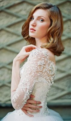White and Gold Wedding. Sweetheart Corset Ballgown Dress. 15 gorgeous Winter Wedding Dresses | bellethemagazine.com