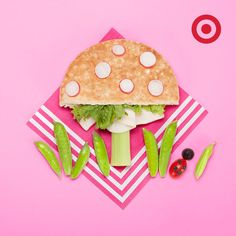 A mushroom-shaped pita sandwich with fresh toppings makes a great kids' school lunch.