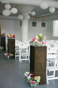 Modern loft aisle. Photography by katiekettphotography.com, Wedding Planning by paramounteventschicago.com, Floral Design   Lighting   Decor by flowerfirm.com