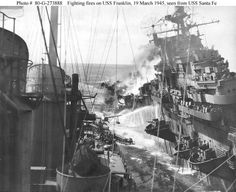 World War II History USS Franklin (CV-13): Burning off the Japanese coast after she was hit by air attack, 19 March 1945. Photographed from USS Santa Fe (CL-60), which was alongside to help with firefighting and rescue work.