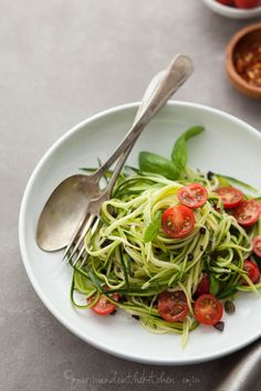 Zucchini Noodles with Caper Olive Sauce and Fresh Tomatoes on gourmandeinthekitchen.com  Zucchini Noodles with Caper Olive Sauce and Fresh T...