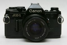 Canon_AE-1_front_with_50mm_lens canon f1, ae1 program, 35mm camera, canon ae1, gadget, best film camera, photographi idea, classic camera, ae1 canon