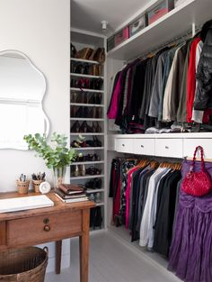 great closet idea with drawer between hanging sections and extra storage on top