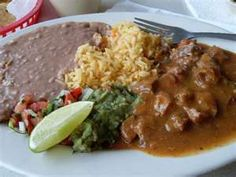 """Carne guisada- by far my favorite Texas favorite! And then the rice and beans too! MMM..."" One recipe I found: http://homesicktexan.blogspot.com/2009/01/carne-guisada-tex-mex-stew.html"