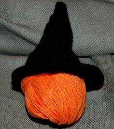 This tiny witch hat is perfect for putting on top of a wee pumpkin. Or an orange ball of yarn. Whatever.