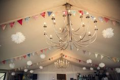 Colorful bunting dresses up a reception hall.   Rock N Roll Bride