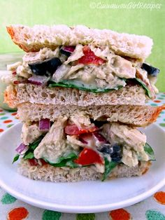 Chicken Salad with Avocado DressingChicken Salad: cooked chicken, chopped or shredded black olives, chopped or sliced red onion, diced tomatoes, sliced or diced baby spinach leaves sliced almonds peasant bread or wraps