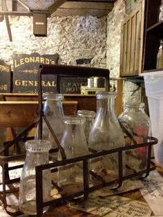 Glass milk jugs would look cool as a spice rack.