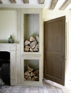 wood shelving by fireplace