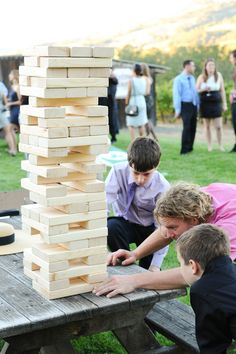 Jumbo-sized Jenga! Love this idea for an outdoor wedding reception {Photo by Larsen's Photography via Project Wedding} fun outdoor wedding ideas, wedding receptions, lawn games, wedding games, board games, outdoor parties, wedding outdoor game, outdoor reception games, outdoor weddings