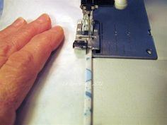 sewing a hem with paper