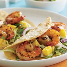 Savor a little Caribbean-style flavor with these soft tacos that are filled with jerk-seasoned shrimp, diced mango and shredded cabbage tossed with red onion, cilantro and rice wine vinegar. #myplate #healthy
