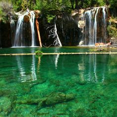 Hanging Lake, Colorado, U.S.A.  Near Glenwood Springs, Colorado is a beautiful mini-lake boasting waterfalls, all sparkling an extra turquiose color because of the mineral travertine that is in the water.  It's also one of the only places where the yellow Columbine flower grows.