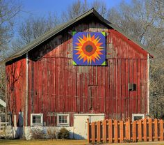 Barn quilt on a fading red barn by Images by MK, via Flickr