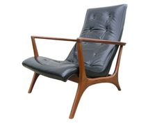 Machine Age | Leather and Walnut Lounge Chair in the style of Vladimir Kagan