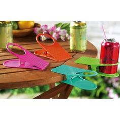 Short on table space? These drink clips let diners clip their beverage to the side of the table. Holds all standard cans, glasses and coffee cups. Anyone Pinter Peeps ever use these before? Wonder how well they would clip to chairs? Well, I'm going to order them and give them a try. Love the tropical colors too!  #summer #barbecues #picnics