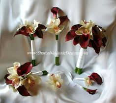 Red Burgundy Calla lilies and white off-white cymbidium orchids