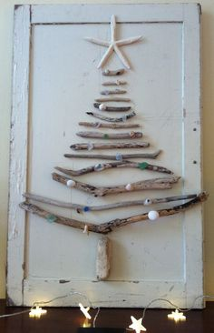 Use of twigs and old cupboard door for excellent x-mas decoration.
