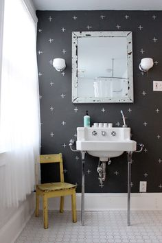love the dark walls of this bathroom.