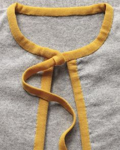 Sew binder tape to your cardigan for an easy color upgrade.