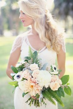 cafe au lait dahlia, garden rose, anemone, ranunculus, chrysanthemums, silver brunia, seeded eucalyptus, fern dusty miller and lemon leaf bouquet by Reverie Events