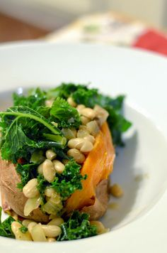 sweet potato stuffed with white beans, kale and mushrooms