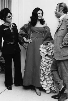 Mrs. Johnson spent as much as 1.5 million per year in the 1970s and 1980s buying fashions for the Ebony Fashion Fair. Here, she poses with designer Bill Blass and a model in 1971.