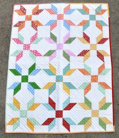 Rose in a Square Baby Quilt by Pleasant Home, via Flickr