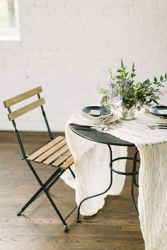 bistro table for the sweethearts, photo by Anne Brookshire http://ruffledblog.com/slate-gray-wedding-inspiration #weddingreception #weddingideas
