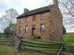 stone/brick colonial saltbox