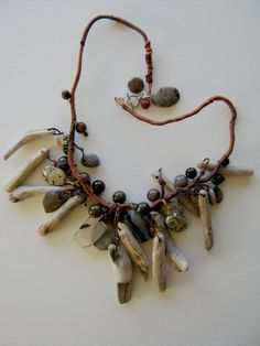 Necklace | Judy Corlett. Driftwood pendants, agate slices, jasper, pietersite beads,  beach stones and  wrapped cord