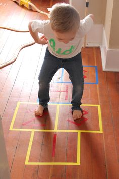 Help the little ones get rid of endless energy by keeping them occupied. All you need is colorful painter's tape to make this fun indoor hopscotch game.