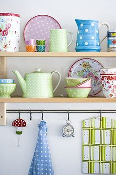 happy kitchen ware on shelves