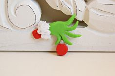 This would be cute sticking out of the Christmas tree or a wreath.  Grinch hand!