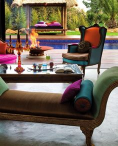 Love the jewel tones and living space open to the pool area