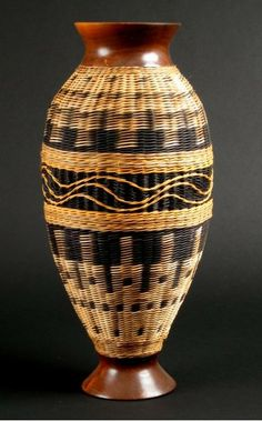"""""""Illusion"""" by Jerry Maxey - For some years Jerry used mainly dyed rattan & sea grass to weave his unique baskets. When he got access to a wood shop, he began to make baskets with wooden bases, then later with wooden rims & rings. The basket's rim & base will usually come from the same log. He loves taking rescued firewood & transforming it into art / http://www.jerrymaxey.com"""