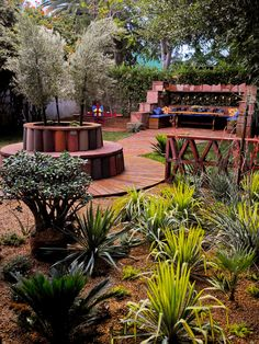 Warm and Inviting.    Jamie Durie used Sonoman design details — including Mexican roof tiles — to create this richly hued outdoor space. Colorful drought-tolerant plants complete the look