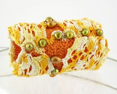 arm cuff crocheted with pearls orange and bamboo by piabarile