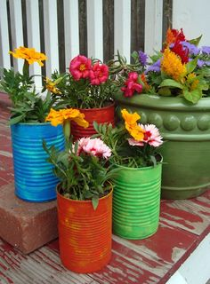 Clever idea for porch decoration / Recycled soup cans turned into flower pots.