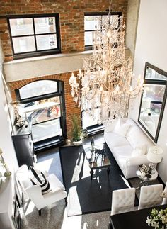 giant chandelier and exposed brick wall beautiful