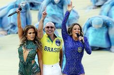 """And the games have begun! Check out #GlamLatinos Jennifer Lopez, Pitbull, and Claudia Leitte onstage during their performance of """"We Are One."""" So much belleza on one stage we just can't take it! #WorldCup #Brazil"""