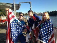 I think the guy in the middle is questioning his friends' treatment of the U.S. flag