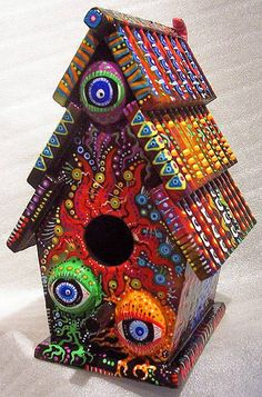 This gives me an idea... buy a ready made birdhouse from craft store, glue something on it interesting... then paint with lots of bright colours and intricate designs.  Like!!