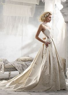 Alvina Valenta Spring 2012 bridal collection  Strapless sweetheart neckline bridal ball gown with pockets, featuring alencon lace bodice with silk organza floral satin ribbon belt at natural waist.